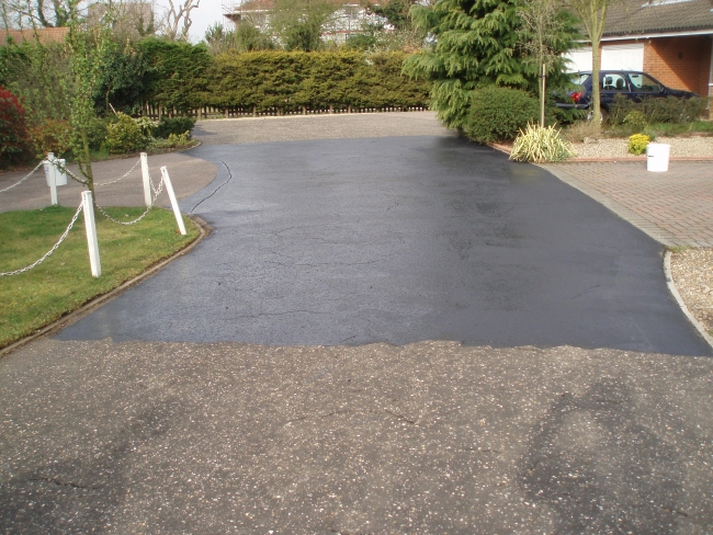 the two coat painting process will prolong the life of the tarmac