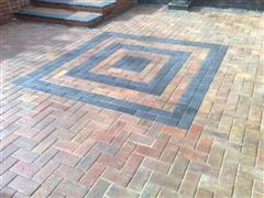 After cleaning the block paving, resanding and sealing the block paving looks like new.
